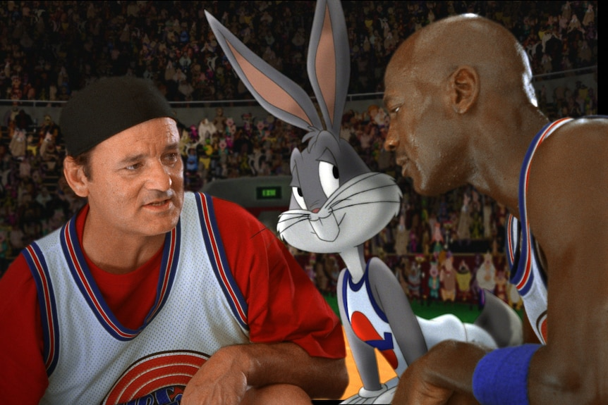 Bill Murray, Bugs Bunny (animated) and Michael Jordan in the movie Space Jam