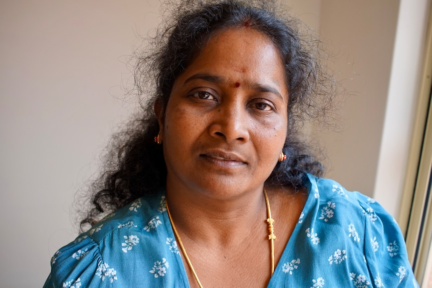 Portrait of a tamil woman wearing a blue floral top