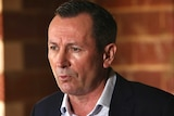 WA Premier, Mark McGowan, speaks at a media conference inside a building site in Piara Waters, Perth