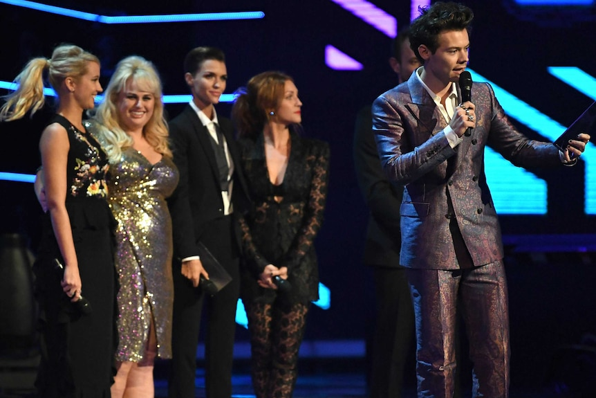 Four women and Harry.