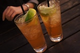 Two glasses of lemon lime and bitters with ice