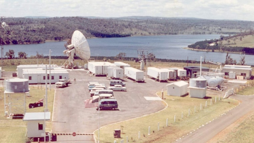 An aerial view of the NASA base at Cooby Dam showing a dish and numerous small buildings