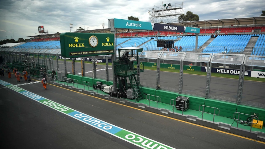 Pitlane at the Australian F1 grand prix lies empty aside from a few team workers.