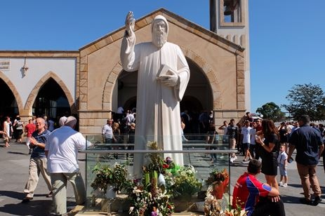 Statue of 19th century Lebanese monk and priest St Charbel outside of church.