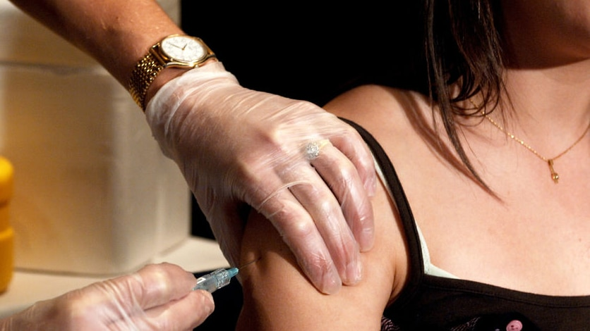 Woman receives a vaccination