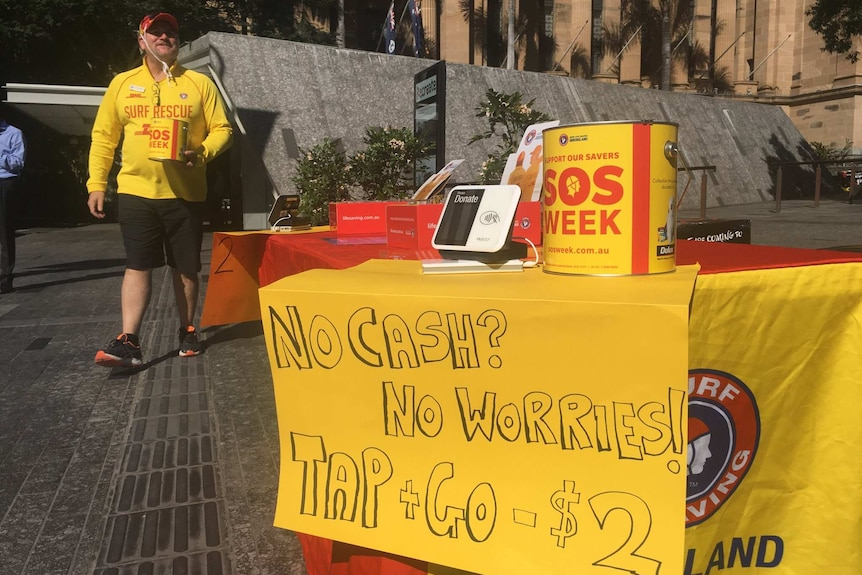 SLSQ volunteer in King George Square collecting donations for SOS Week
