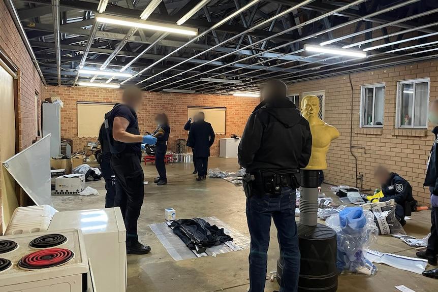 AFP officers raid a property