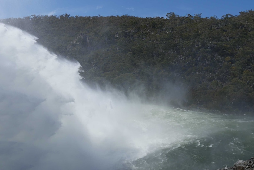 Water from Snowy River blows in wind
