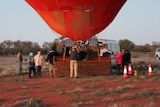 Passengers boarding a hot air balloon ride in Alice Spring.