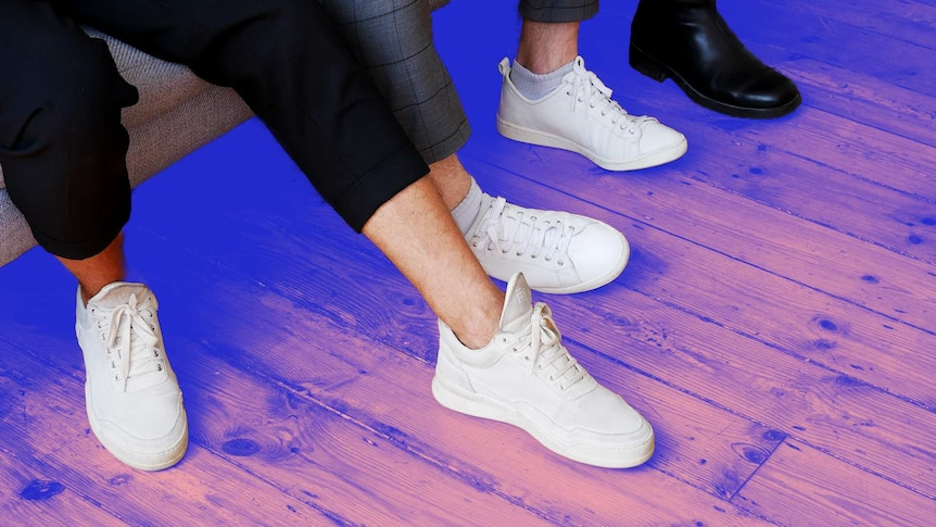 Close-up of people wearing white sneakers and black boots in a story about looking after food health while working from home.
