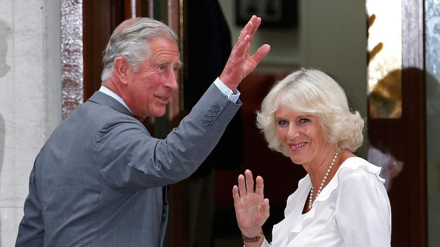 Prince Charles and Camilla wave to crowd outside hospital