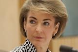 Michaelia Cash looks to the side during Senate Estimates.