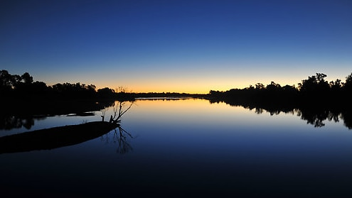 The sun sets over the Gilbert River in North Queensland