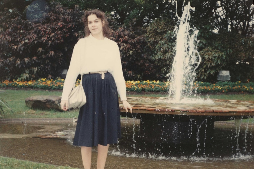 An old image of Anne-Marie Culleton standing in front of a fountain.