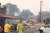 firefighters observing the destroyed remains