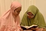Shereena and Emilee Kai reading the Quaran