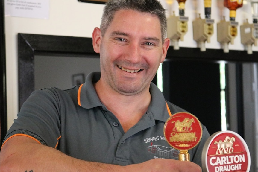 Kahl Murphy, a publican in Caramut, stands behind the bar