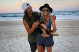 Australian snowboarder and Olympian Alex Pullin with his girlfriend Ellidy Vlug and their dog Rummi on the beach.