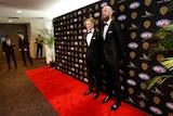 Two Melbourne Demons players pose in their tuxedos ahead of the Brownlow Medal ceremony in Perth.