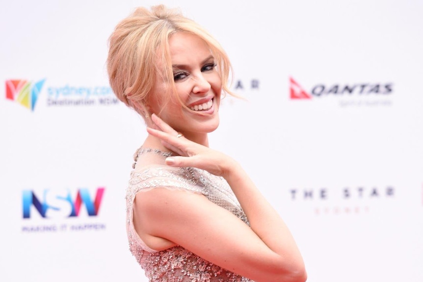 Kylie Minogue poses on the red carpet for Arias 2015