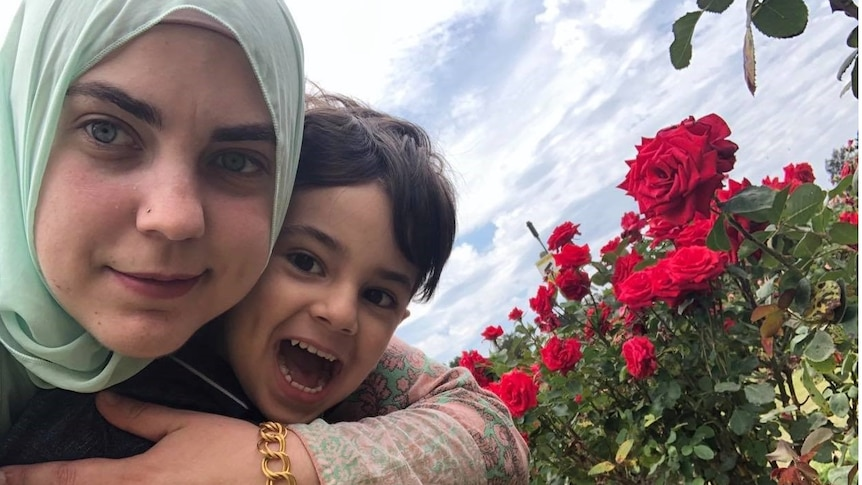 Betul Khan and her young son