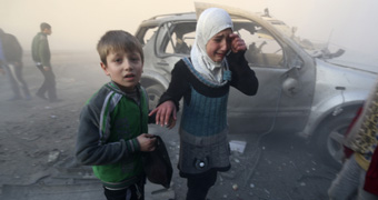 Syrian children in Aleppo street after bombing