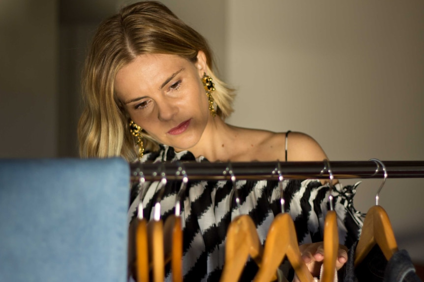 Anna Mabin looking through clothes