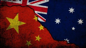 China and Australian flags superimposed on cracked earth