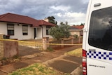 A house with police van parked out the front