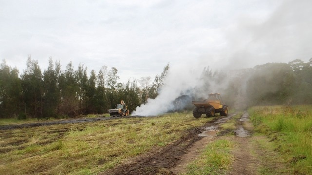 NPWS crews have spent months excavating smouldering chitter at Crangan Bay and cooling it.