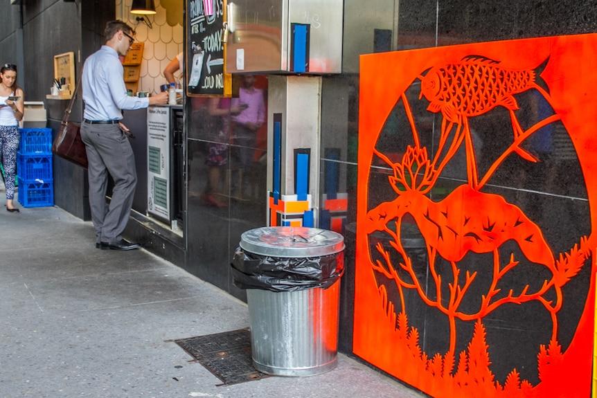 A large cut out appears alongside a popular Brisbane cafe near Eagle Lane.