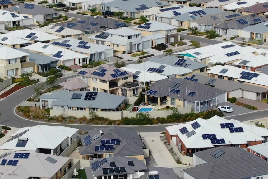 Solar panels on homes in a new suburb from a drone