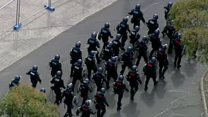 An aerial shot of armed police officers.