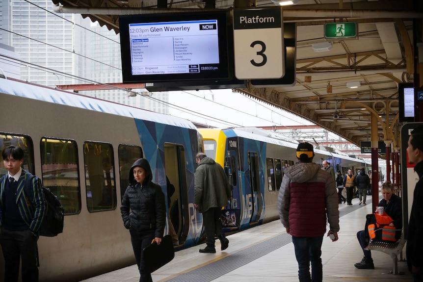 A few passengers board a Glen-Waverley bound train at Flinders Street Station