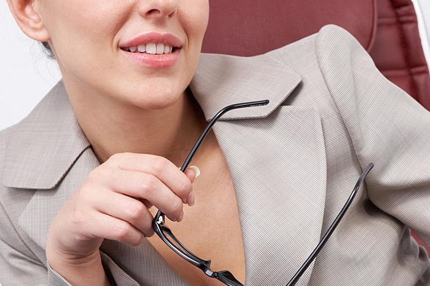 Woman in business clothes at a meeting.