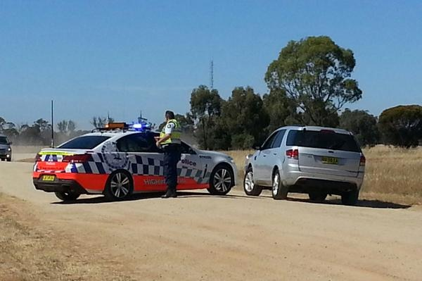 Police cars at Old Deniliquin Road, north of Moama where two people were found dead