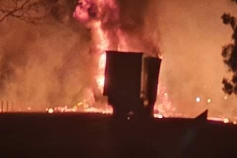 A truck engulfed in flames.