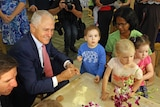 Malcolm Turnbull playing with children at a daycare centre.