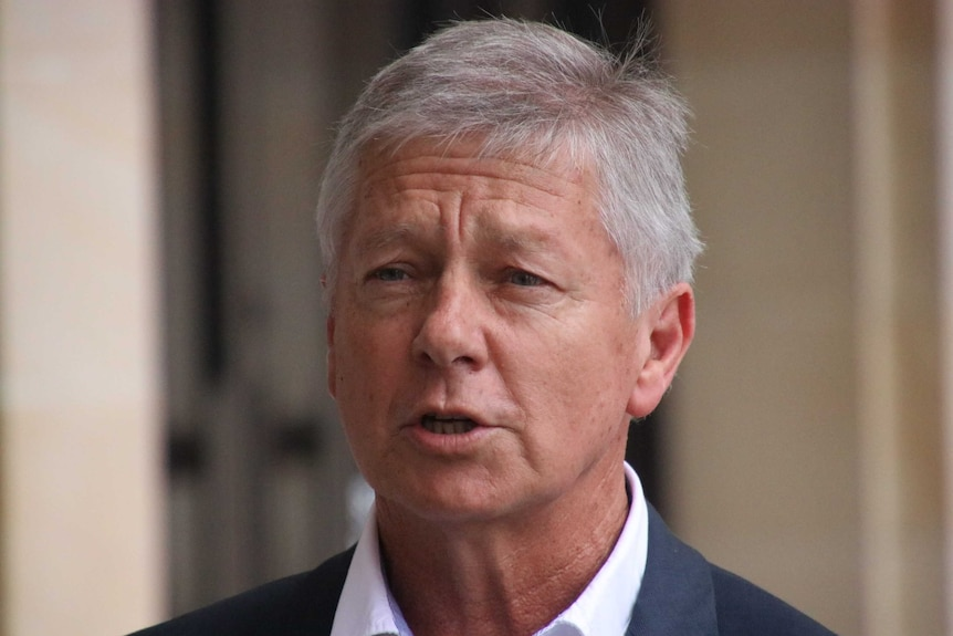 WA Liberal health spokesman Bill Marmion being interviewed by reporters outside State Parliament