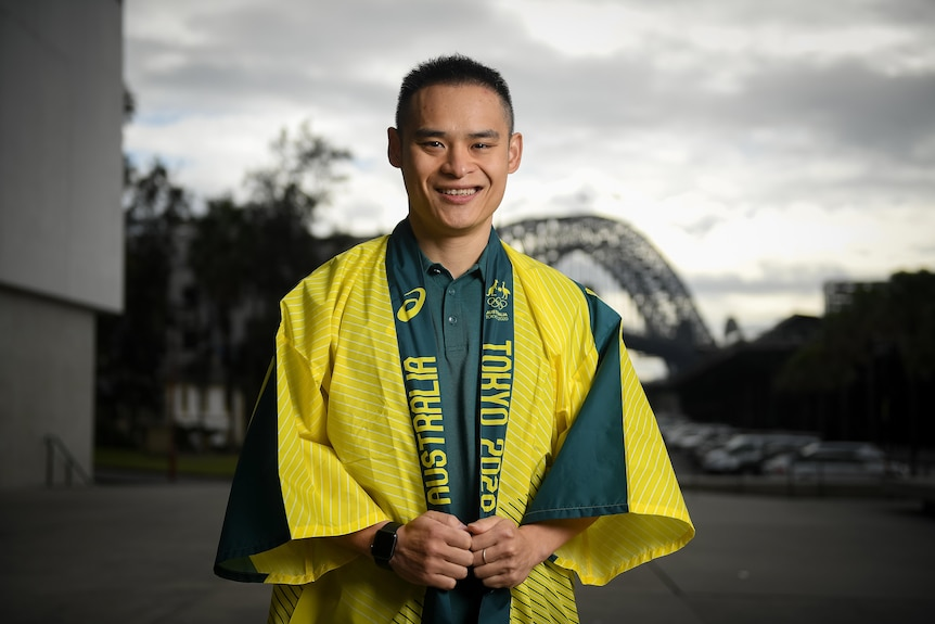Man smiling for a photo after being selected to compete for Australia at the Tokyo Olympic Games for diving