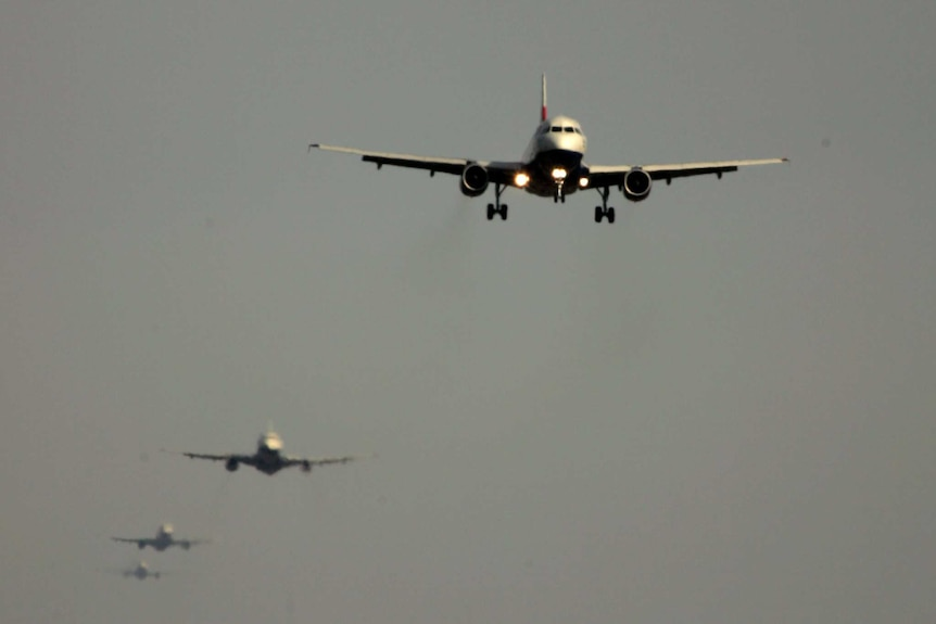 Planes line up, waiting to land at Heathrow Airport
