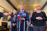 SA Premier Steven Marshall speaks to media with SA Health authorities and a sign language interpreter beside him.