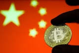Representation of the Bitcoin cryptocurrency is seen with Chinese flag in the background.
