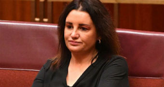 Jacqui Lambie sits in the senate after resigning over dual citizenship.