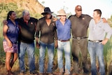 Indigenous men and women standing side by side with pastoralists in the Kimberley outback