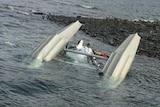 A sea plane's landing gear is seen upside down submerged in water