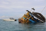 A pontoon sinks after springing a leak in Nusa Lembongan.