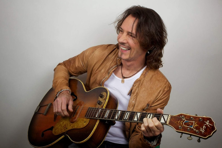Rick Springfield with his guitar