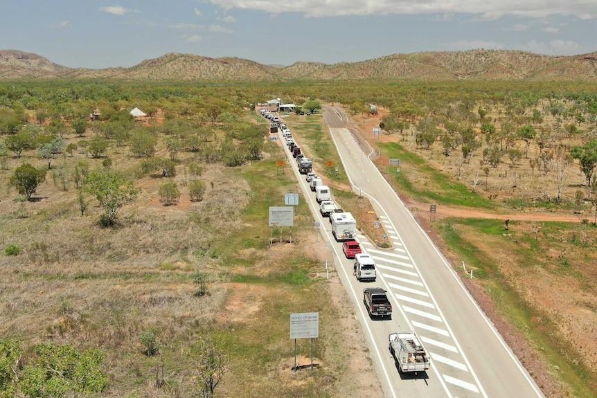 A line of cars at the WA/NT border
