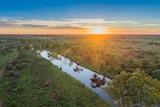 Sunset over a suddenly teeming creek near Warburton, Western Australia.